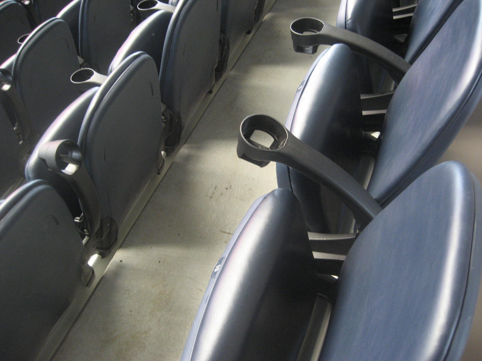 Padded seats with cupholders