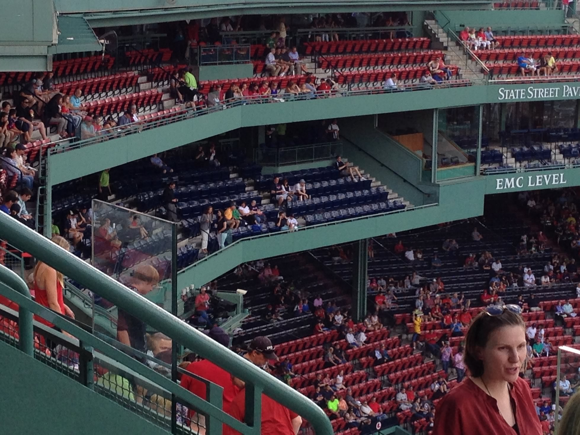 The EMC Club seats behind home plate are located just above the Grandstand and just below the Pavilion Club All Grandstand seats at Fenway Park