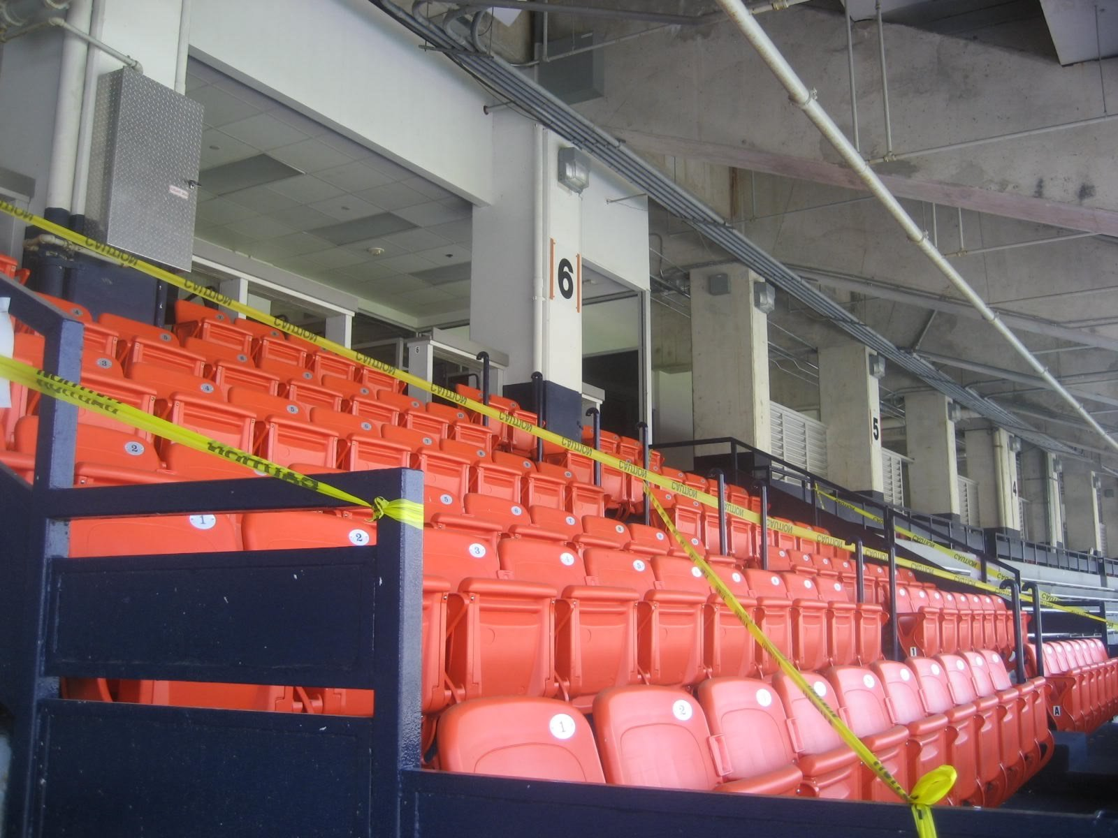 All Seats In The Beckwith Club Are Plastic Chairbacks That Fully Under Cover
